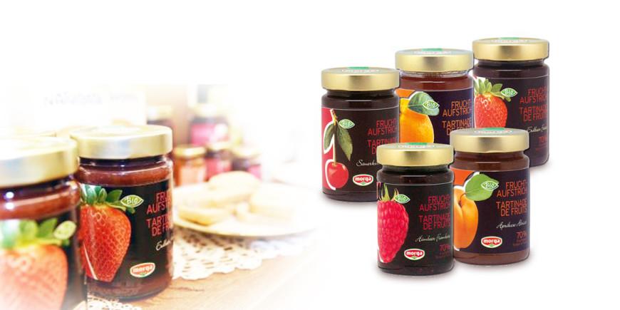 Bio-Fruchtaufstrich Kirsch, Bio-Fruchtaufstrich Erdbeer, Bio-Fruchtaufstrich Aprikose und Bio-Fruchtaufstrich Orange im Glas von Morga